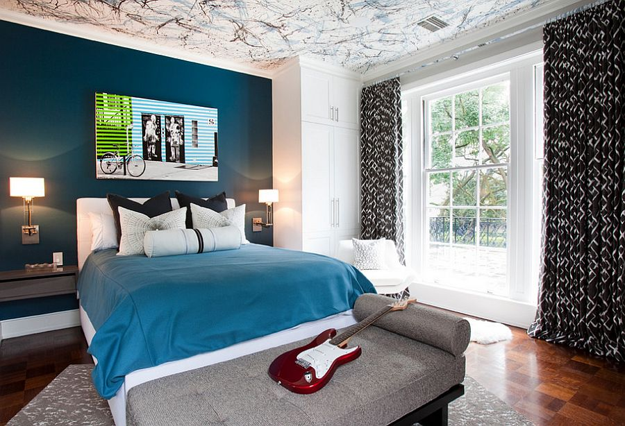 Splatter paint in three different colors creates a trendy ceiling in the teen bedroom [Design: Laura U]