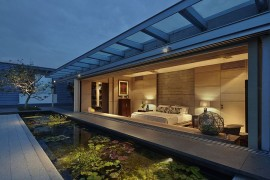 Lily pond and brass terrarium add serenity to a Singapore home