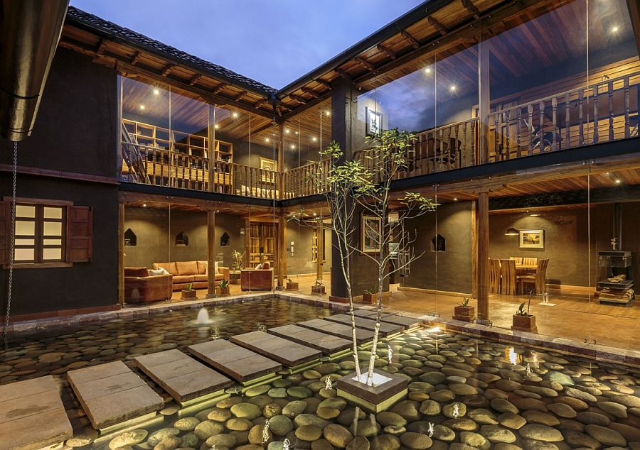 Stunning courtyard with reflective pond and river rock