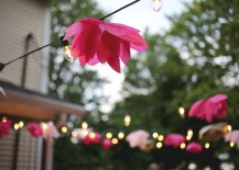 Tissue paper flowers embellish a string of outdoor lights 217x155 Celebrate Spring with These Colorful Party Ideas