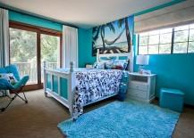 Tropical bedroom draped in delightful, bright blue