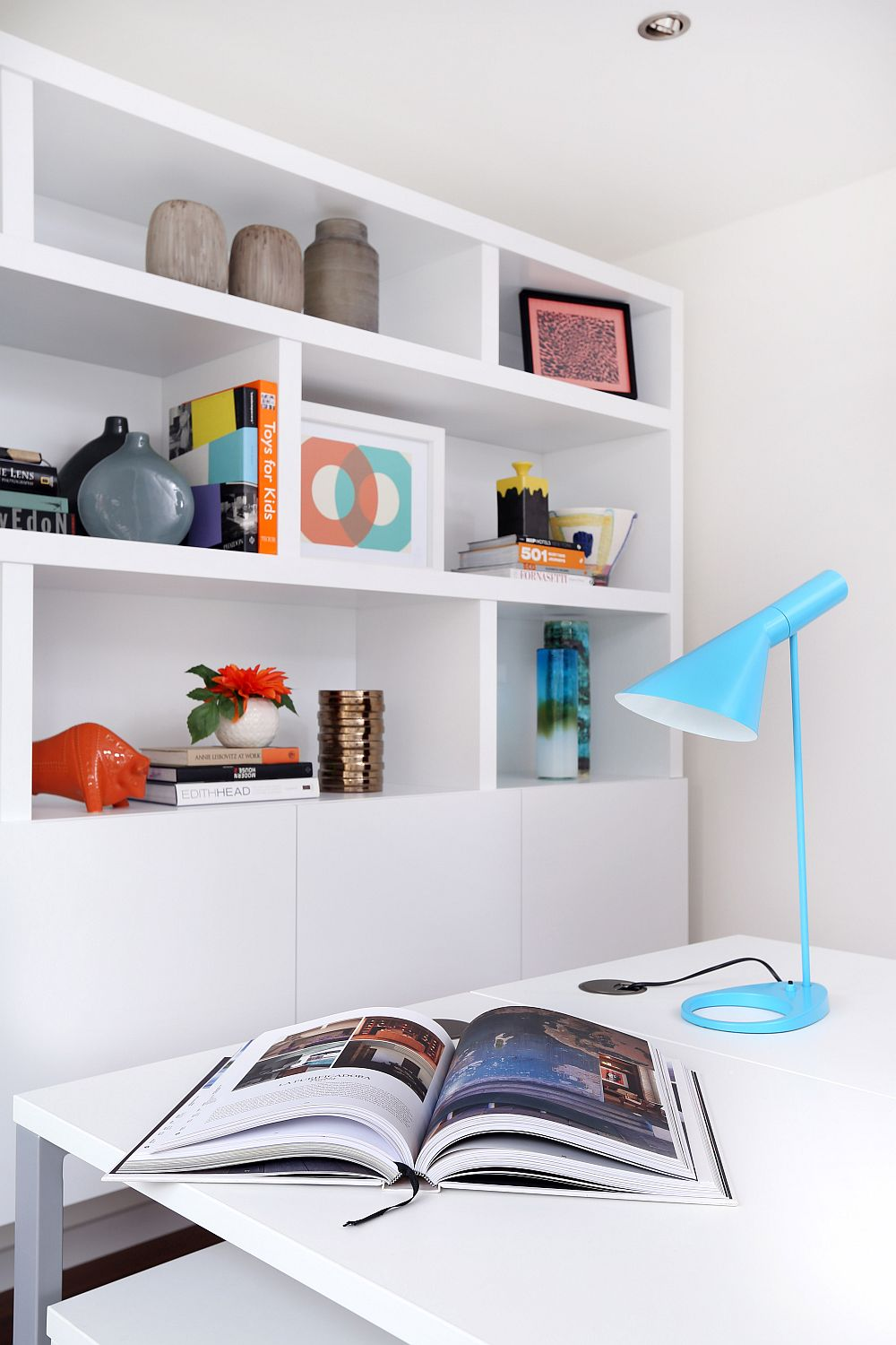 Turquoise Arne Jacobsen AJ table lamp on the work table