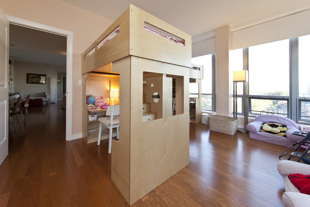 Two Dumbo loft beds share storage stairs with a view