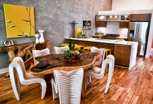 Unique gray backdrop and pops of yellow enliven this eclectic kitchen [From: Gallery Direct]