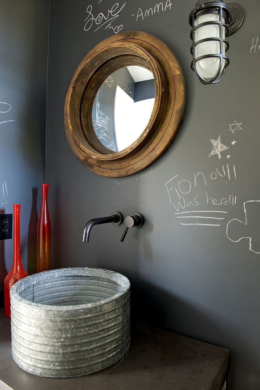 Unique mirror and chalkboard wall in the small bathroom