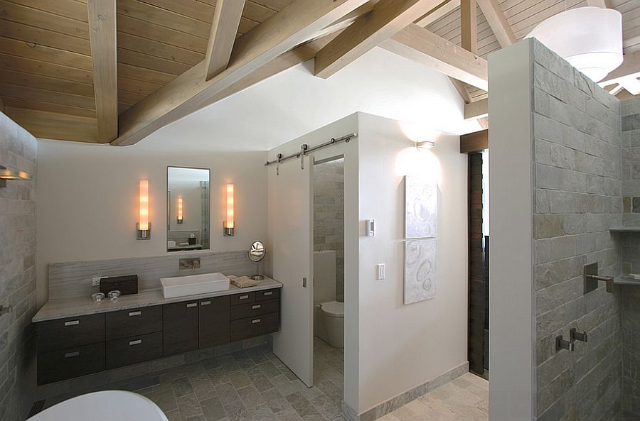 Using the sliding barn door for the toilet closet in the master bathroom [Design: Masterson Studio]