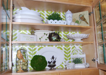Using wrapping paper to spruce up the inside of kitchen cabinets