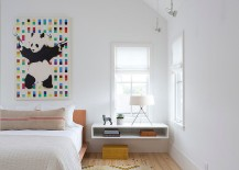 Wallart and chic rug add color and pattern to the stylish Scandinavian bedroom