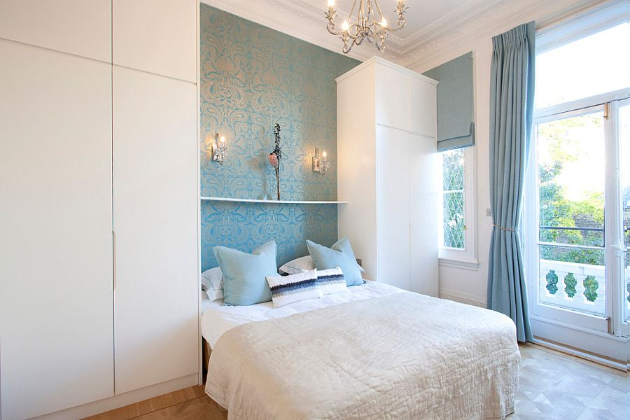 Wallpaper adds to the blue and white color palette of the bedroom [Design: Increation Interior Design]