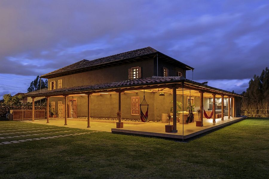 Warm lighting adds to the aura of the modern rustic home in Ecuador