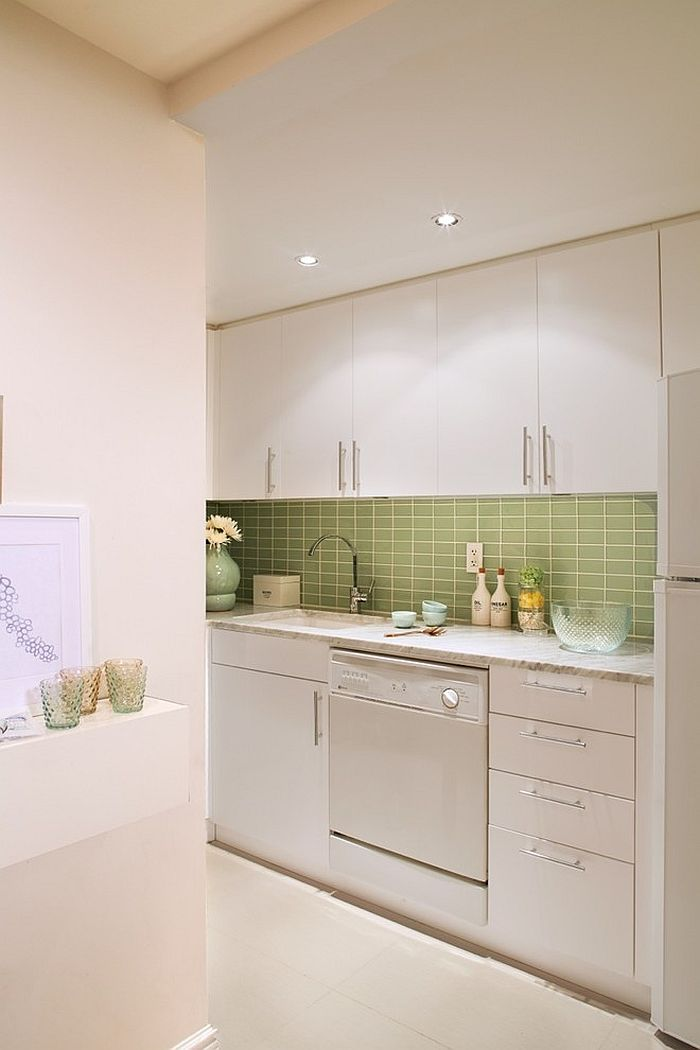 White Scandinavian kitchen with a gorgeous green tiled backsplash