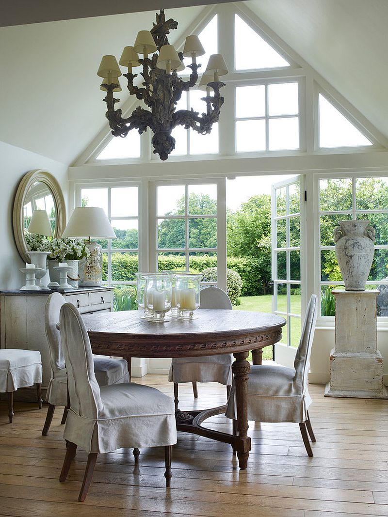 Windows and doors in the backdrop fit into the casual farmhouse style [Design: Paolo Moschino for Nicholas Haslam]