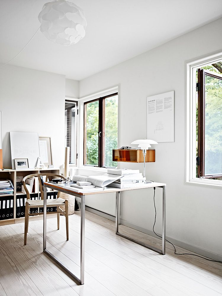white airy home office. wishbone chair and sleek desk give the home office an airy ambiance design arends white n