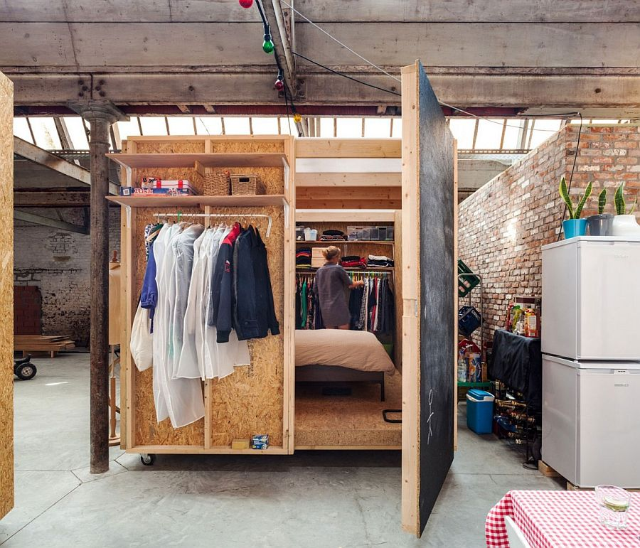 Wooden box containing the temporary bedroom inside the factory