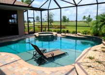 Wrought iron lounger pool 217x155 10 New Ways to Think About Wrought Iron for the Garden or Patio