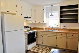 Yellow wood kitchen made over with white paint black interiors  8 Low-Cost DIY Ways to Give Your Kitchen Cabinets a Makeover Yellow wood kitchen made over with white paint black interiors 270x180