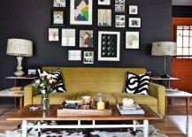 A gallery grouping of art pops against black walls