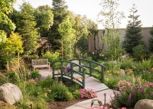 A serene garden with an elegant bridge in French green