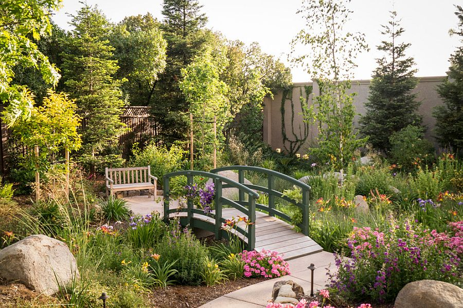 A serene garden with an elegant bridge in French green [Design: Design Focus International]