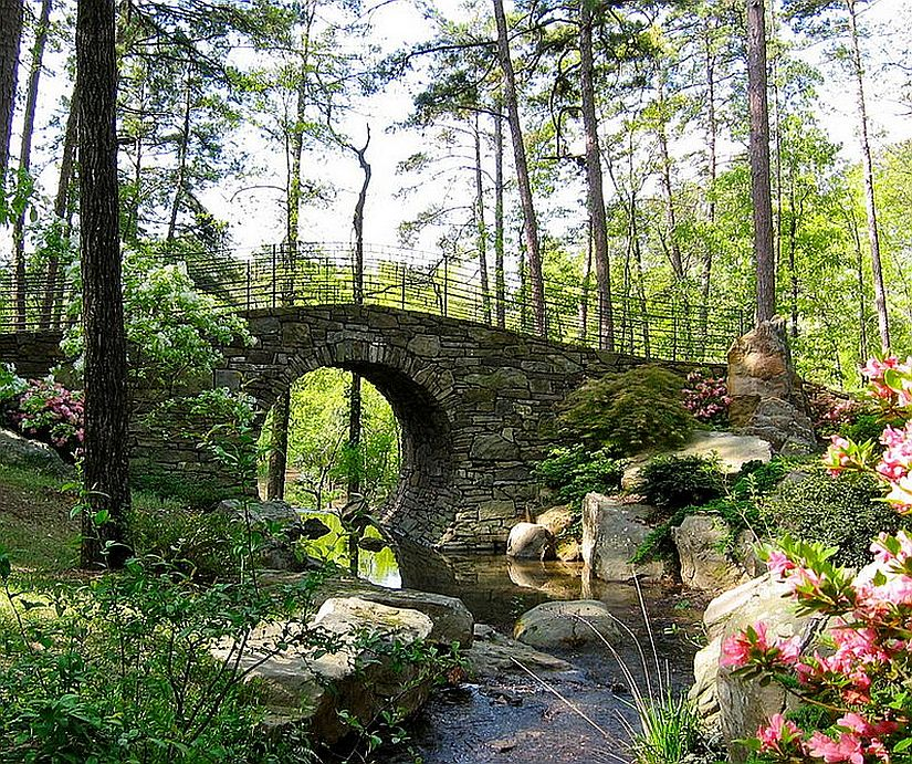 A stunning stone bridge for the English-style garden [Design: MESA Landscape Architects]