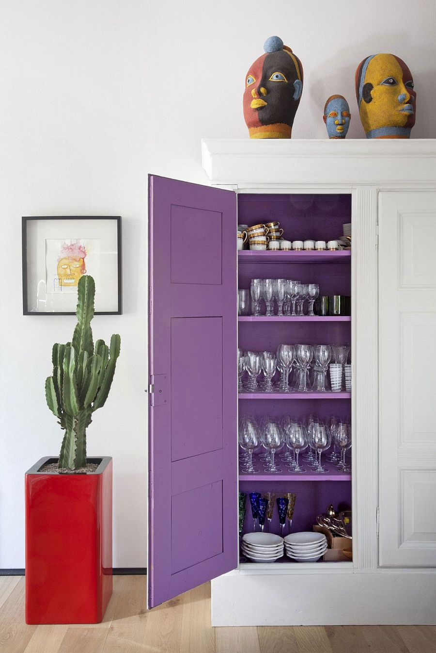 A touch of purpe charm on the inside of the dining room wall cabinet