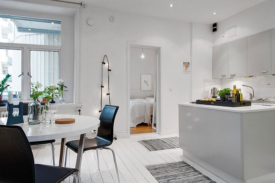 All-white kitchen and dining area of the Scandinavian home