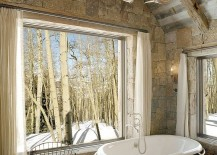 Antler light and large windows provide a balance of natural and artificial lighting