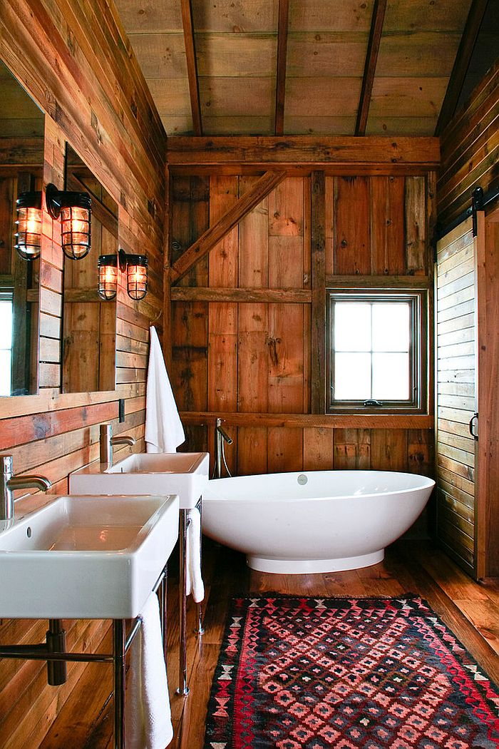 Barn style bathroom with a smart, white standalone bathtub [Design: Northworks Architects and Planners]