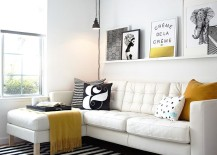 Black and white living room with elegant pops of yellow