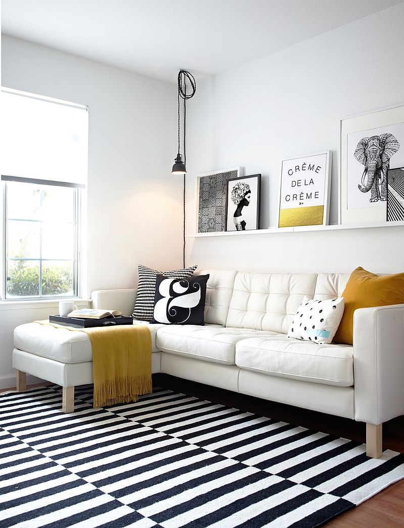 black and white living room with elegant pops of yellow design