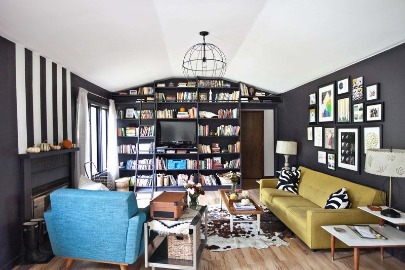 Black living room featuring painted stripes