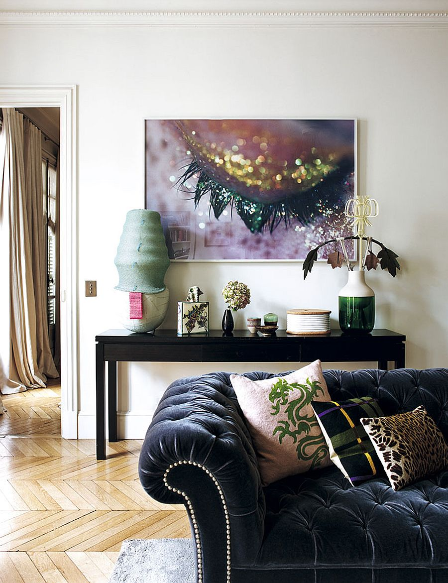 Bold wall art and curated collection of accessories set the mood inside this Paris home