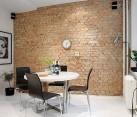 Brick wall presents a unique backdrop for the kitchen