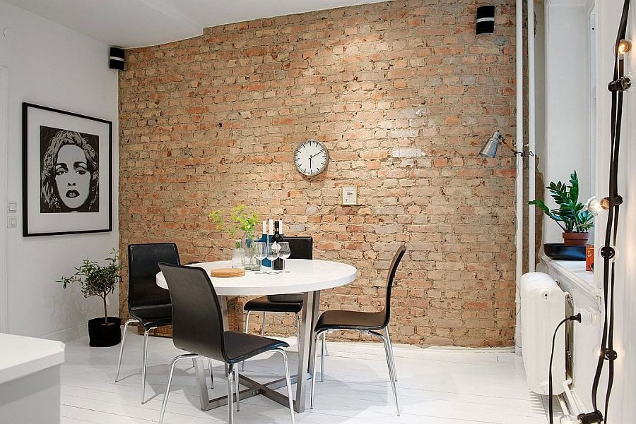 Brick wall presents a unique backdrop for the kitchen