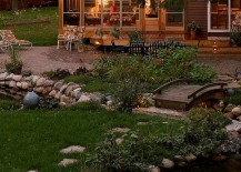 Bridge-over-the-streams-adds-to-the-cozy-rustic-appeal-of-the-cabin-retreat-217x155