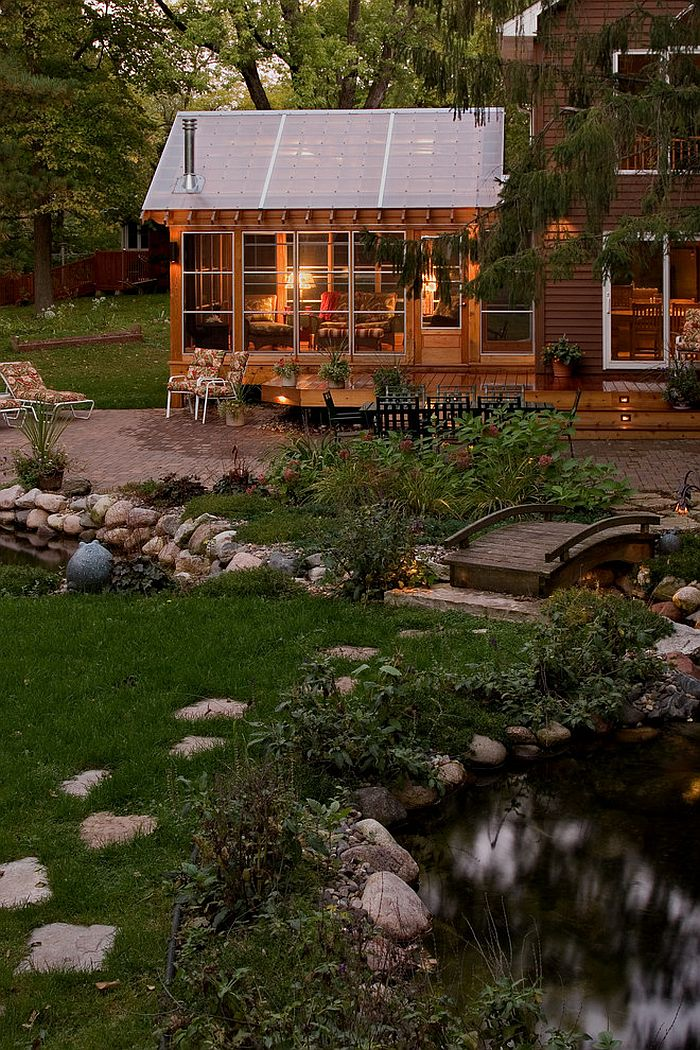 Bridge over the streams adds to the cozy, rustic appeal of the cabin retreat [Design: Quigley Architects]