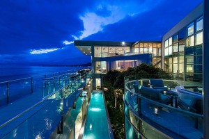 Brilliant lighting adds to the splendor of the stylish beach house