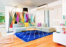 Brilliant living room with creative use of colorful wallpaper and rug
