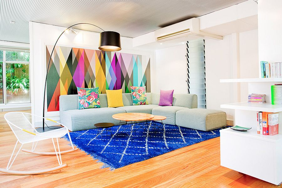 Brilliant living room with creative use of colorful wallpaper and rug [Design: Touch Interiors]