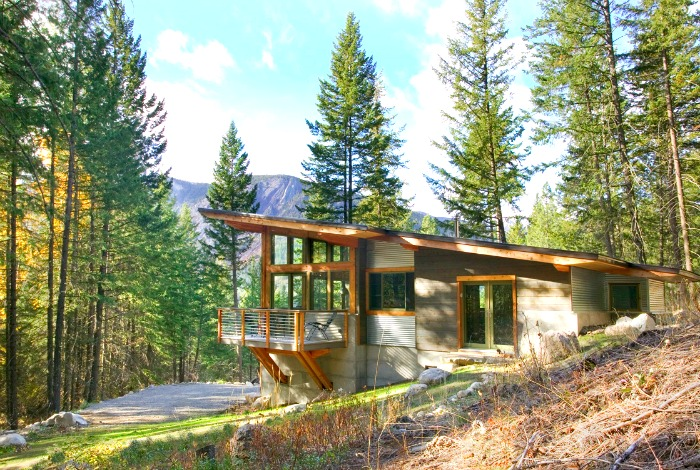 Mountain views and a rushing stream compliment the clean design
