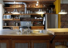 Cabinets add to the industrial style of the kitchen [Design: Esther Hershcovich]