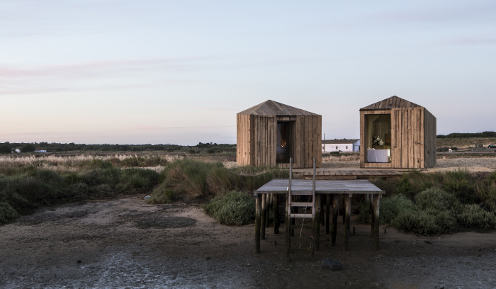 A pair of over-water cabins for relaxing and watching the tide come in