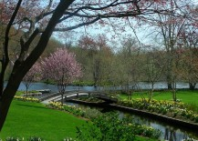 Captivating-landscape-with-natural-creek-and-a-garden-bridge-217x155