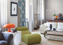 Chaise lounge and table lamp give the room a midcentury twist