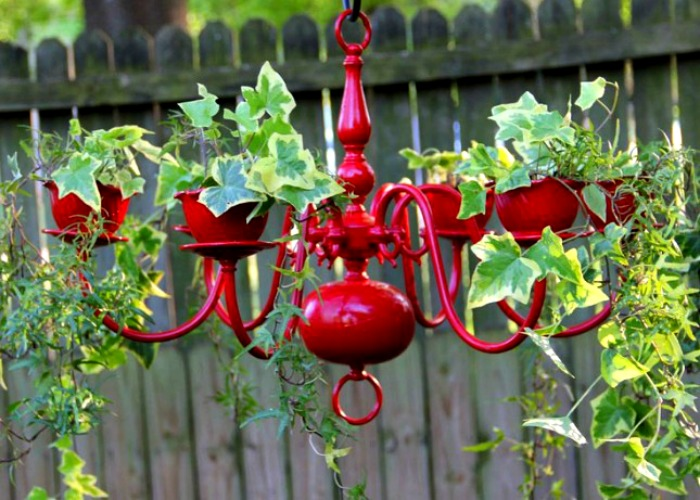 Always keep colors in mind when you are choosing plants—these variegated green ivy leaves look perfect with a glossy red chandelier