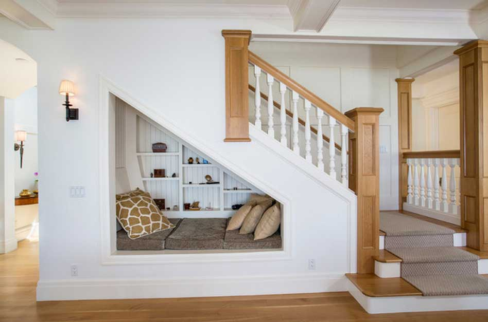 8 clever ways to utilize that awkward space under your stairs for Garde meuble nice