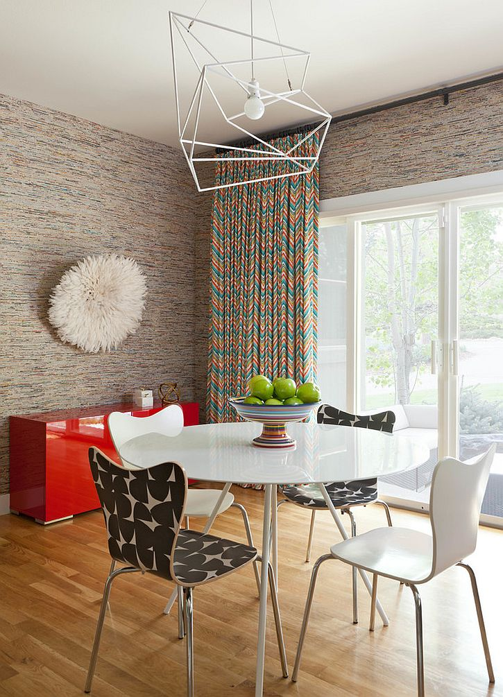 Chic industrial pendant with a wiry frame in the contemporary dining room [Design: Designer Premier]