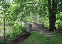 Classic stone garden bridge for those who wish to go beyond wood [Design: Conte & Conte]