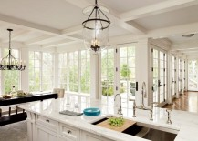 Coffered ceiling in a bright kitchen with marble countertops