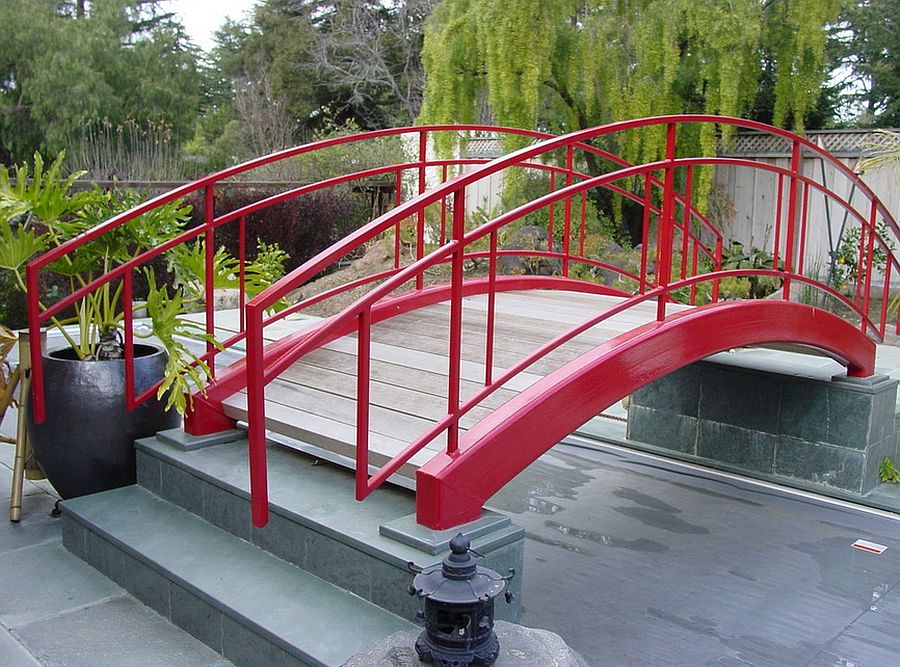 Colorful bridge becomes an instant focal point in the contemporary garden [Design: Brians Welding]